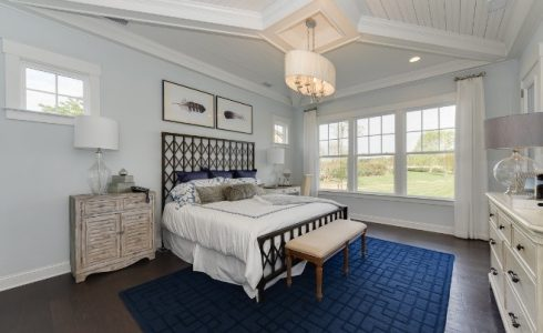 Large first-floor owner's suite with trey ceilings and rustic decor.
