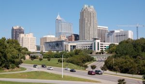 Cityscape of downtown Raleigh, North Carolina from a highway overpass.