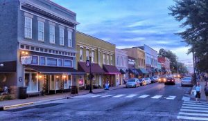 People walking and driving in downtown, historic Apex, North Carolina.