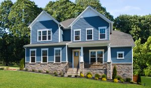 Blue, luxury single-family home in NewMarket at RounTrey inventory home by HHHunt Homes.