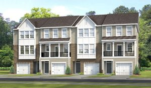 Rendering of garage town homes on wooded lot.