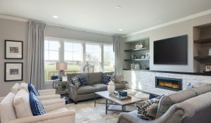 Model family room with TV in Willoughby community.
