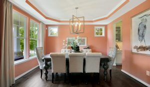 dining room peach walls ornate dining table chairs