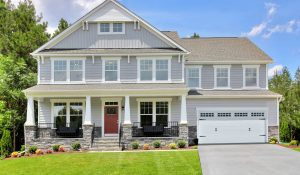 Single-family home with 2-car garage by HHHunt Homes.