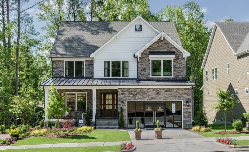 HHHunt Homes two-story home in Cary, North Carolina stone exterior