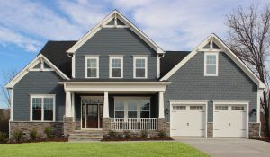 HHHunt Homes Willoughby Crawford model home with two-car garage.