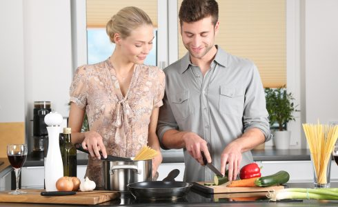Young couple preparing a meal together.