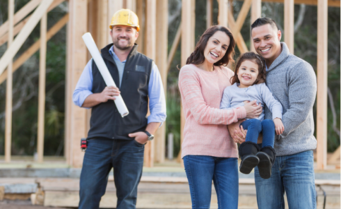 Construction worker with plans and family with child