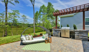 Outdoor patio with sofa and grill