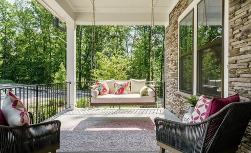 covered porch with swing and chairs