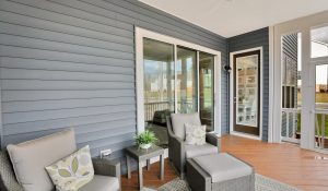 covered deck porch furniture grey siding