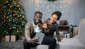 Black couple taking selfie at Christmas