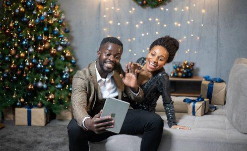 Black couple taking selfie at Christmas