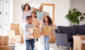 African American family moving into home with boxes
