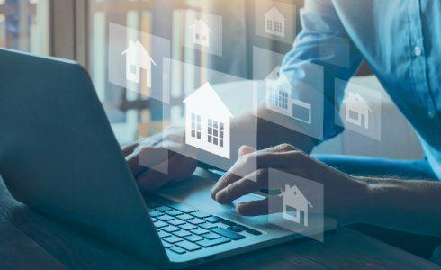man at laptop mortgage lender financing