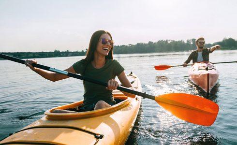 woman kayaking on water